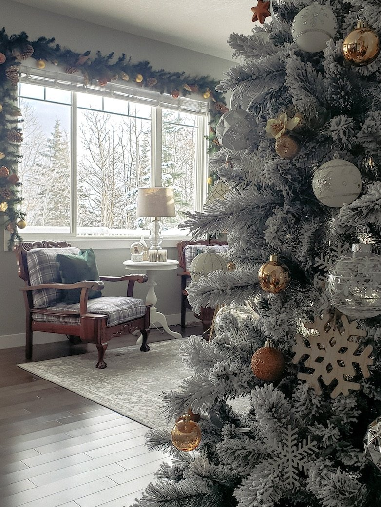 Flocked Christmas tree decorated in neutrals