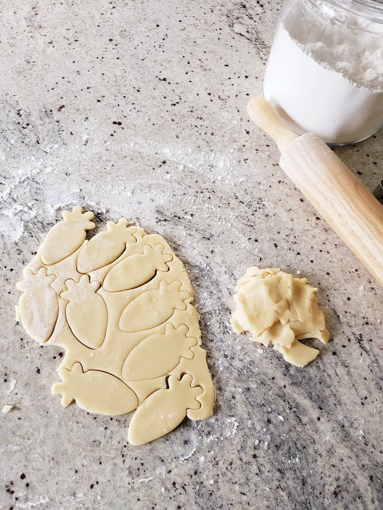 Rolled out dough and shapes made with a cookie cutter