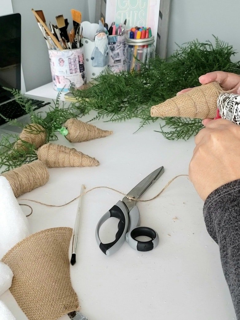 wrapping twine around the burlap carrots