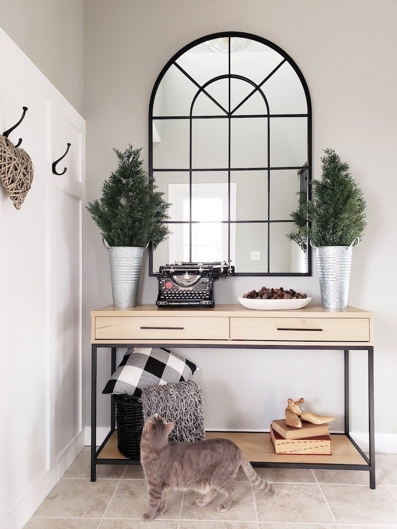 Console table and mirror in an entryway