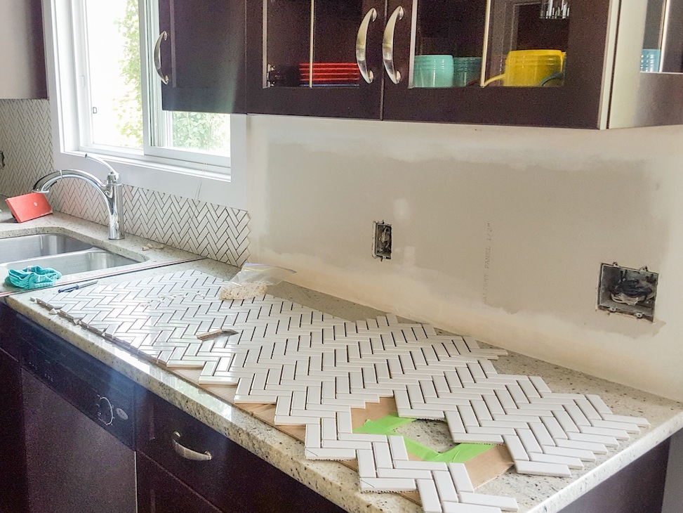 Planning out the placement of mosaic kitchen backsplash
