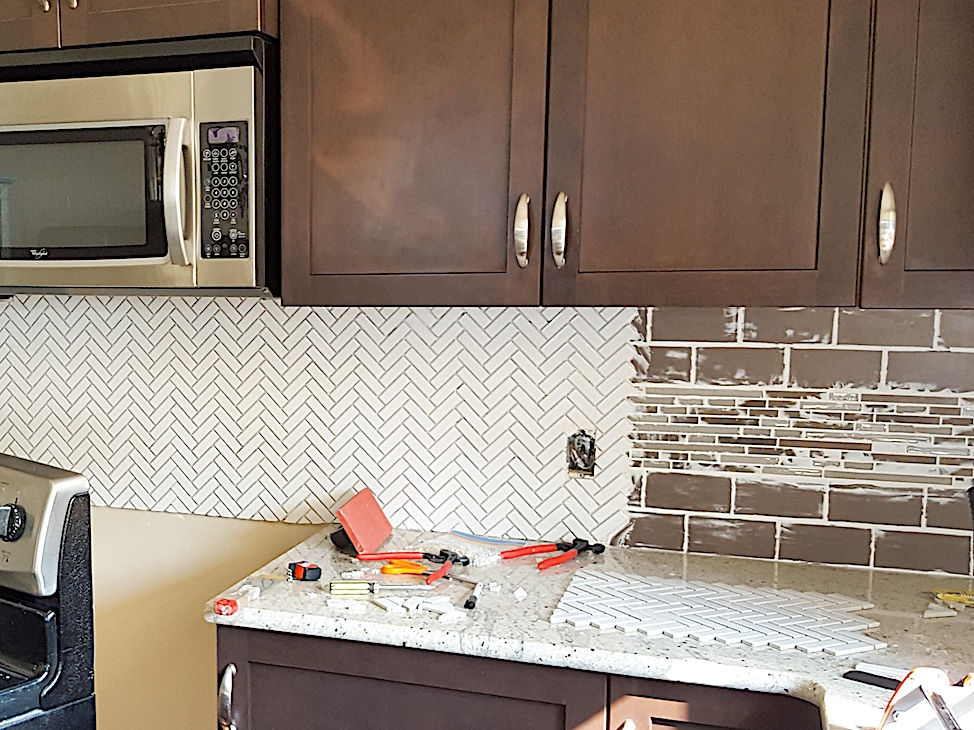 Not ideal, but you can tile on top of your kitchen's existing backsplash