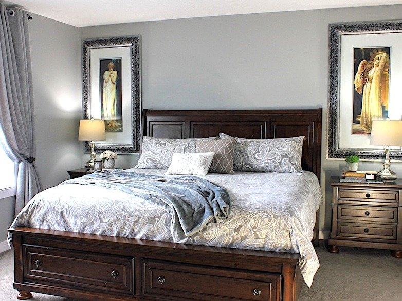 small master bedroom with a king size bed and oversized art