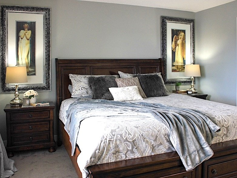 defying the rules of scale and proportion in a small bedroom with oversized furniture and art