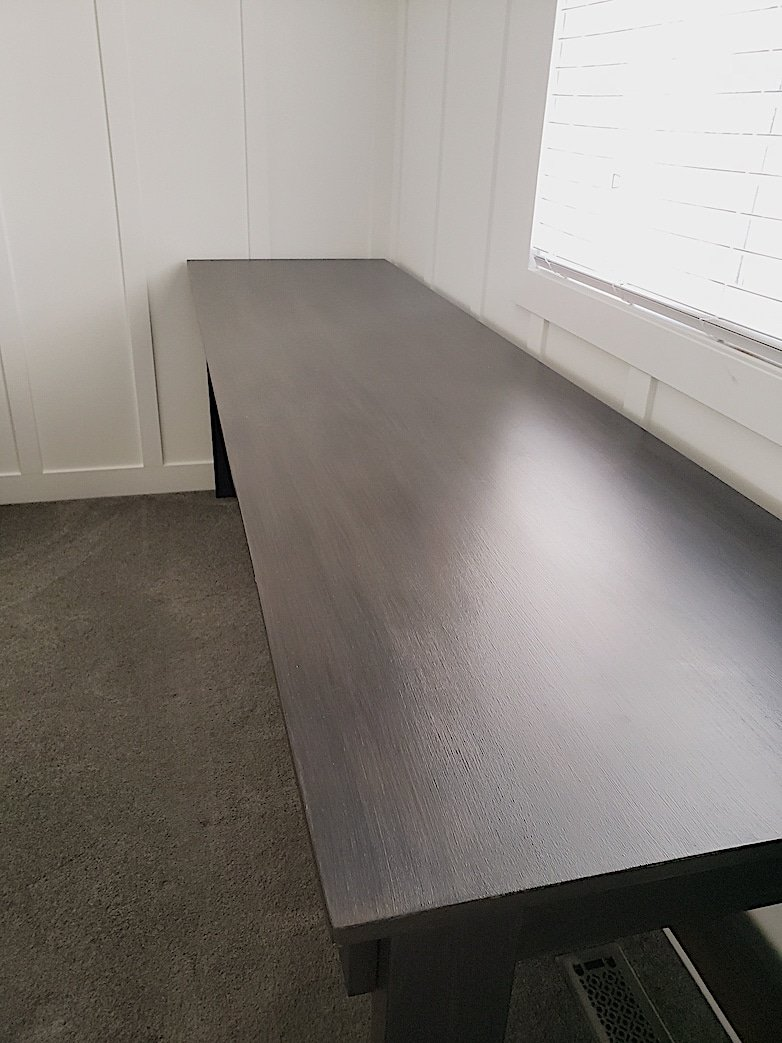 desk table top showing faux wood finish