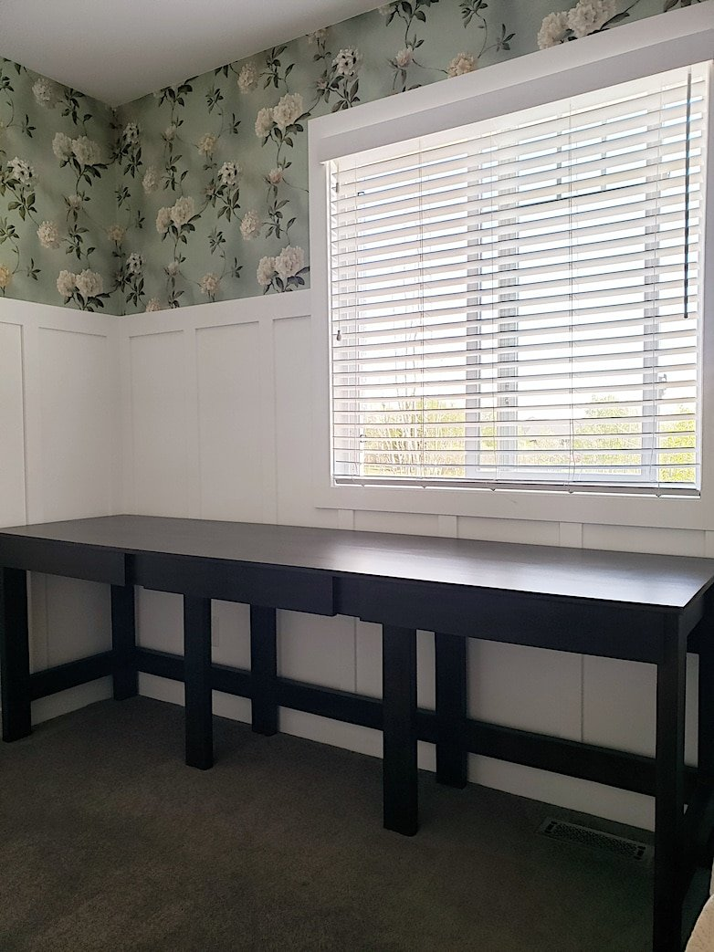 the simple desk with drawers in the space it was built for