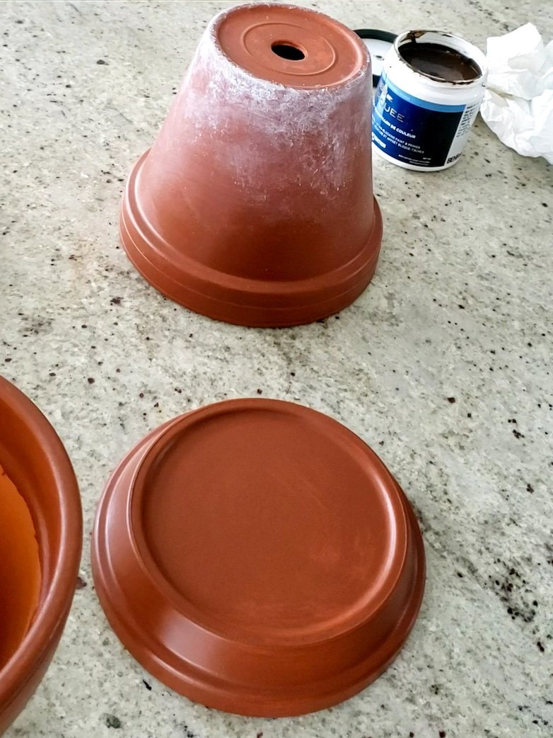 terracotta pot aged with paint