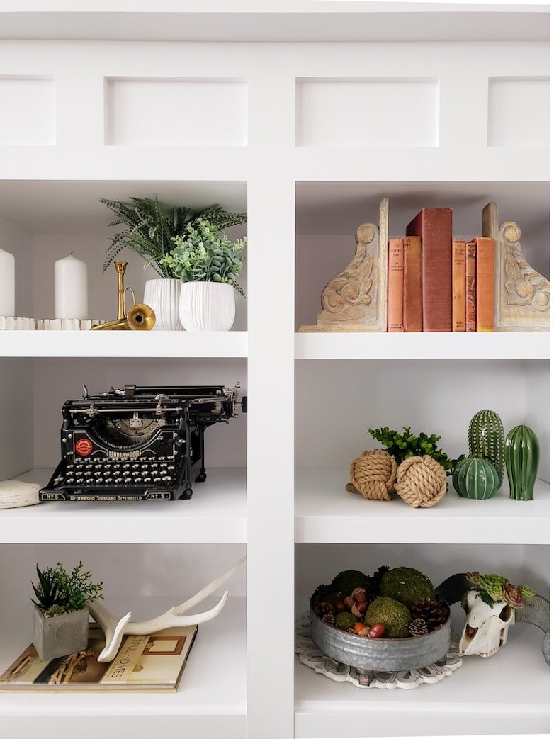 Decorating with vintage finds in white painted built-ins