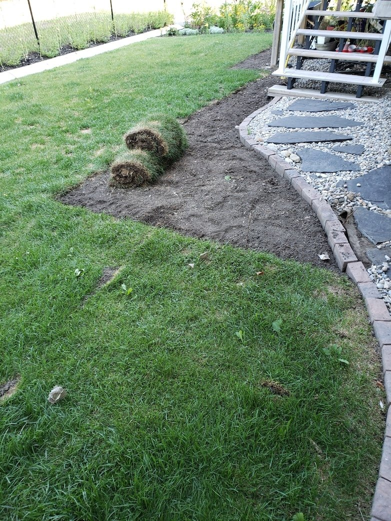 Removing grass to create an outdoor sitting area