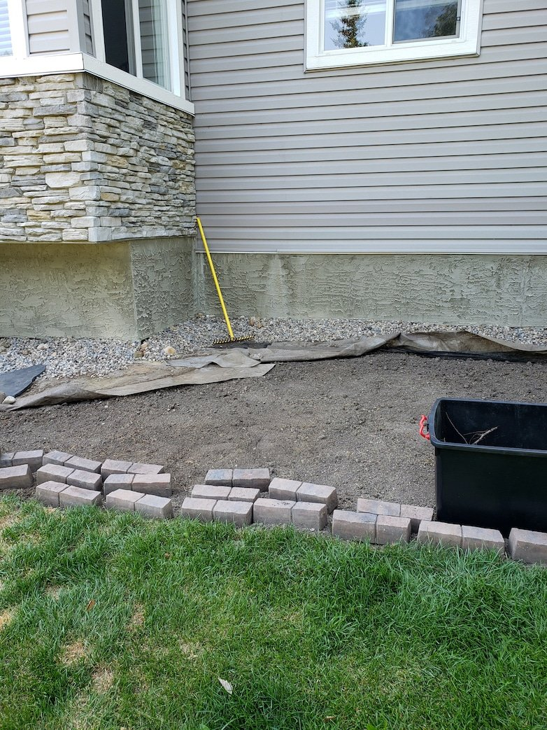 Levelling soil and removing all grass roots