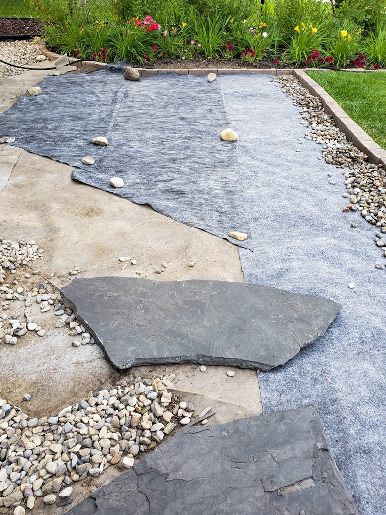 Laying down landscaping fabric