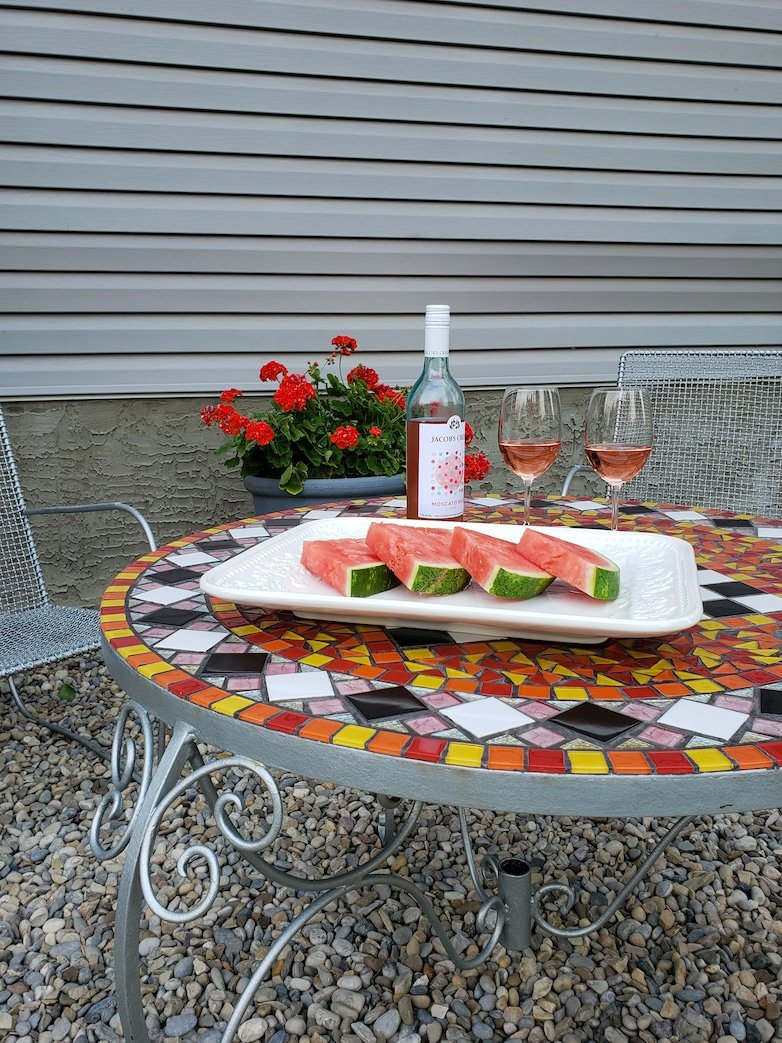 Wine and watermelon served at the outdoor sitting area