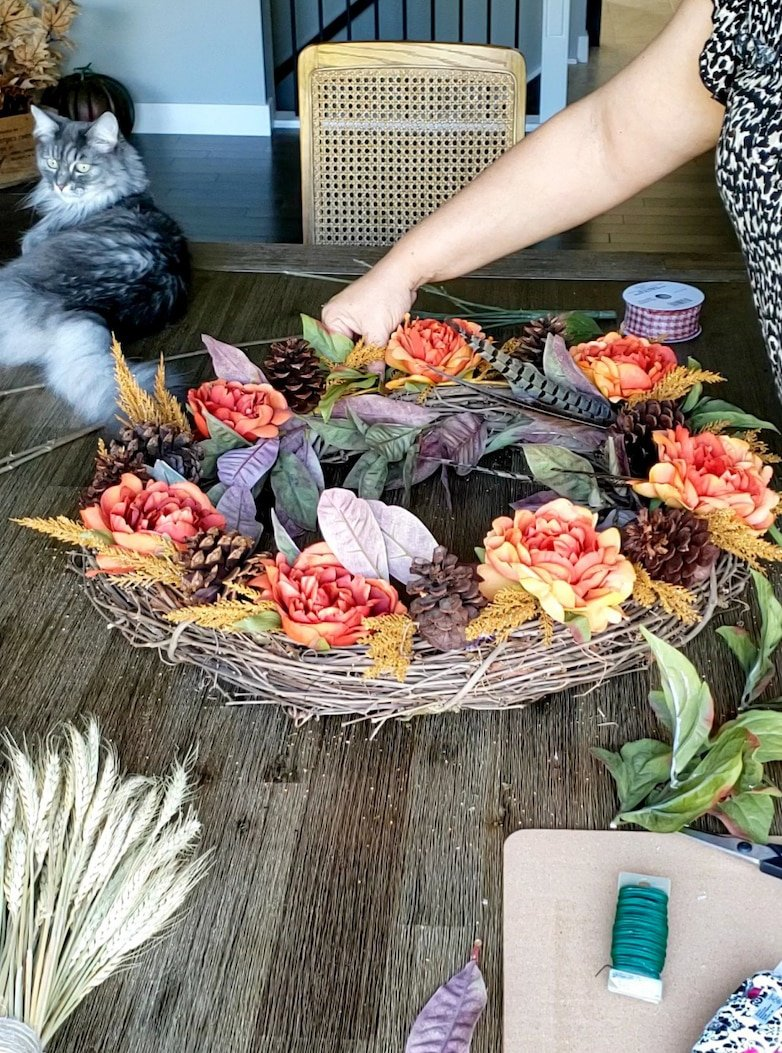 DIY fall wreath made with faux leaves and flowers