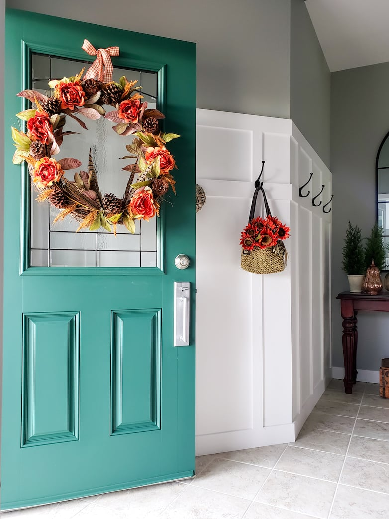 Open front door with a fall wreath