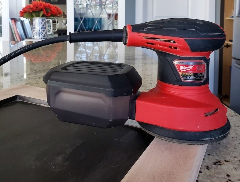 Milwakee orbital sander to prep cabinets for painting